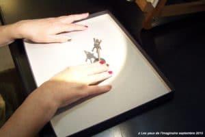 Toucher de l'ombre - le dispositif avec la boite